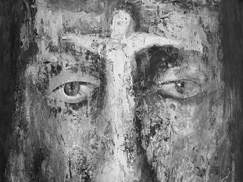 Monochrome painting of face and cross