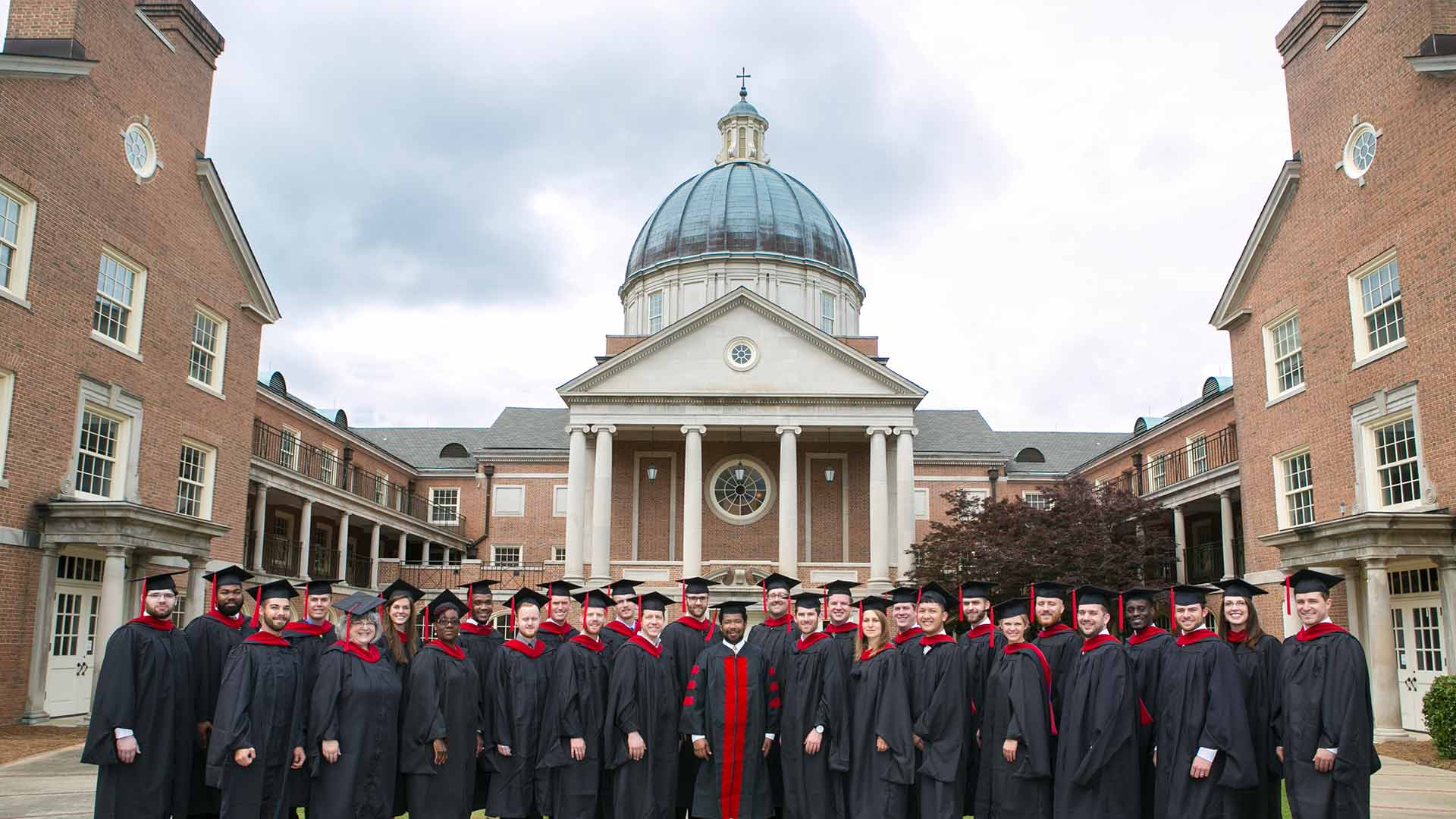 beeson graduates in front of chapel